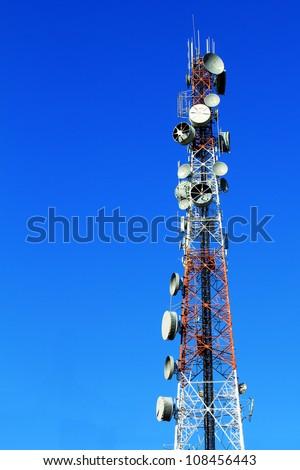 telecommunications tower with many satellite dish