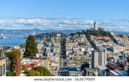 Telegraph Hill - A panoramic view of neighborhoods of Telegraph Hill, Coit Tower and San Francisco Bay, looking from top of Russian Hill, San Francisco, California, USA.