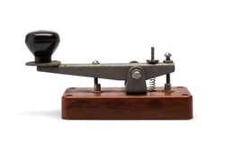 Telegraph key or Morse key isolated on white background. Vintage Morse code telegraphy device side view.