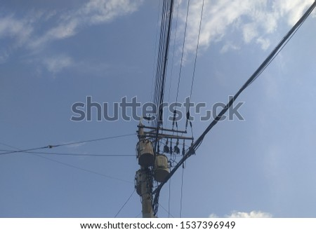 telegraph pole, telephone pole with clear sky