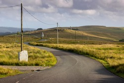 Telegraph poles on a Welsh country road in the Brecon Beacons, South Wales, UK