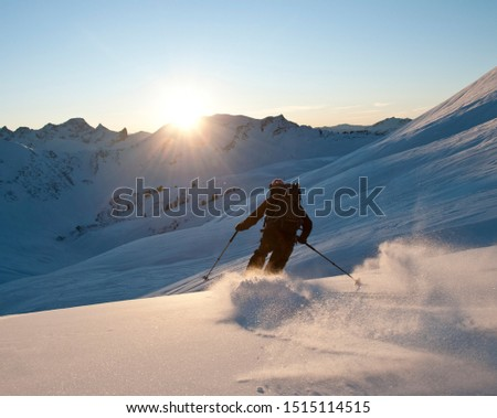Telemark skiers doing late afternoon tour in the mountains of Kleinwalsertal in austrian alps #1515114515