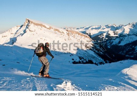 Telemark skiers doing late afternoon tour in the mountains of Kleinwalsertal in austrian alps #1515114521