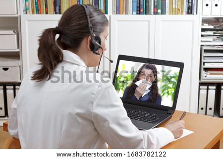Telemedicine concept: doctor or pharmacist with headset during a video consult with a patient with the flu.