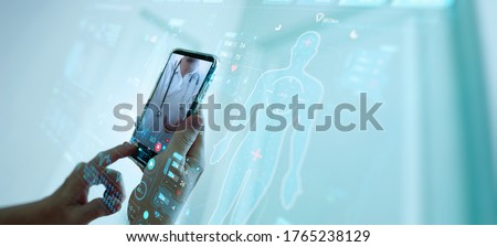 Telemedicine concept,Hand holding smartphone Medical Doctor online communicating the patient on VR medical interface with Internet consultation technology.