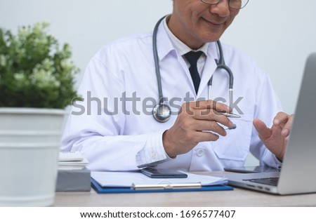 Telemedicine, Medical online, e health concept. Smiling doctor video chat with patient via laptop computer, mobile health application. Doctor video conferencing, cropped image.