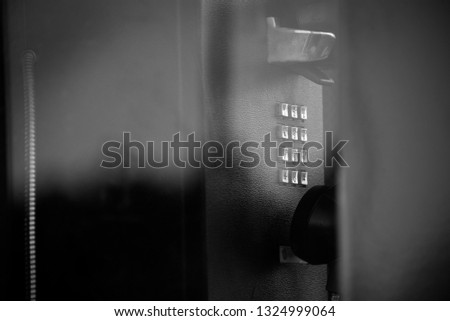 Telephone from a telephone booth in black and white  #1324999064