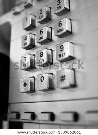 Telephone from a telephone booth in black and white #1339862861