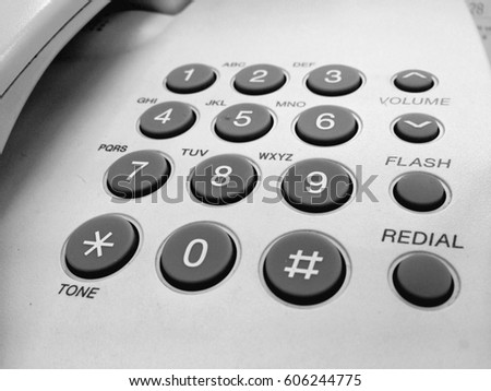 telephone keypad with buttons numbers and letters close up