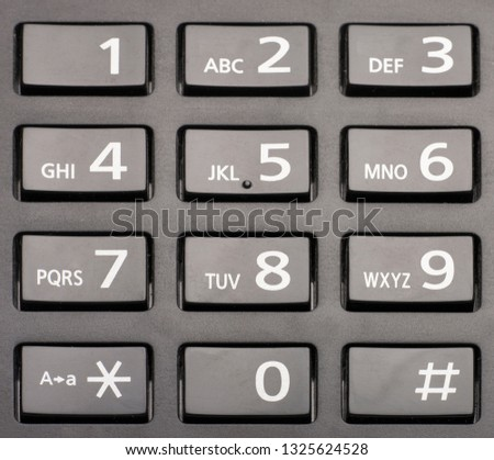 telephone keypad with rectangular buttons close up Limited depth of field #1325624528