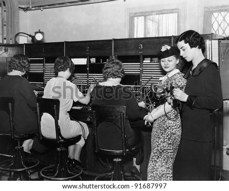 Telephone operators at switchboard