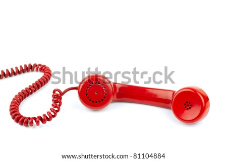 Telephone receiver and cord, isolated on white background