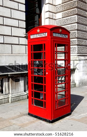 Telephone sign on London Telephone Booth - stock photo
