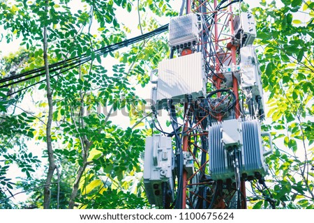 Telephone transmitter connection system at cellular phone antennas in rural areas.Telecommunication mast television antennas.Control box.Development communication.Telecom tower.