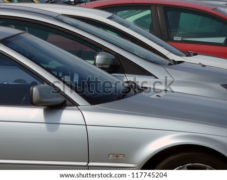 Telephoto view of cars parked in car park