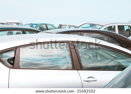 Telephoto view of cars parked in crowded car park