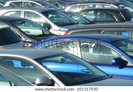 Telephoto view of cars parked in Leeds parking lot