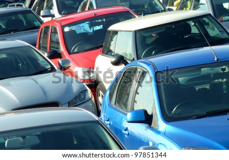 Telephoto view of cars parked in parking lot. Image can be reversed for non British uses. Useful for environmental issues.