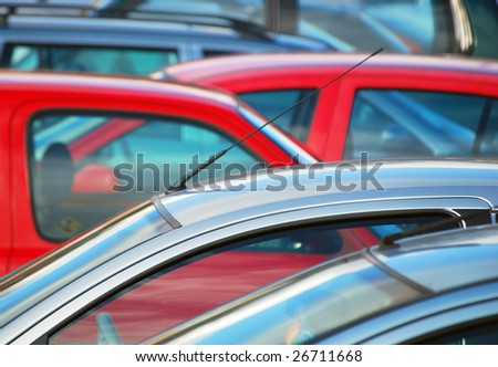 Telephoto view of parked cars in parking lot