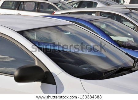 Telephoto view of parked vehicles in car park
