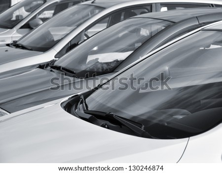Telephoto view of vehicles parked in parking lot