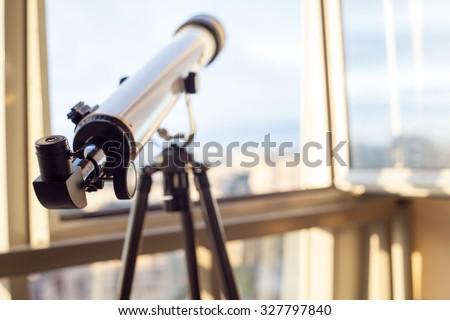 telescope on the balcony, home surveillance, small depth of field