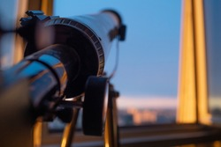 telescope on the balcony, Telescope on the tripod, shallow. Telescope for sky observation, Hobbies and training for children. low depth of field