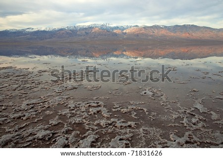 Telescope Peak reflected in flooded Badwater Basin, Death Valley National Park, California.