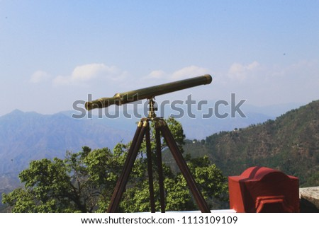 Telescope used for a better view of the landscape at Camel's Back road,Mussoorie,India.