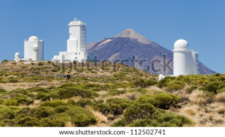 Telescopes of the Astronomical Observatory Izana with the mount Teide in the background, Tenerife, Canary Islands. - stock photo