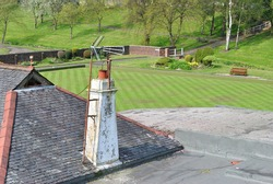 Television Aerials on Old Rooftop Chimney Stack  with Distant Bowling Green