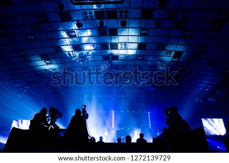 Television broadcast by a cameraman during a concert. Camera with the operator is on the high platform. #1272139729