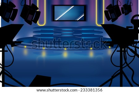Television Studio. A TV studio with desk,lighting and cameras waiting for broadcast, lighting illuminates and reflects on the shiny studio floor.
