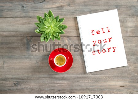 Tell your story. Creative workplace flat lay. Notebook, cup of coffee, succulent #1091717303