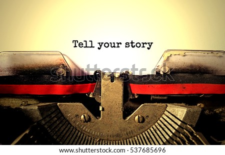 tell your story typed words on a vintage typewriter #537685696