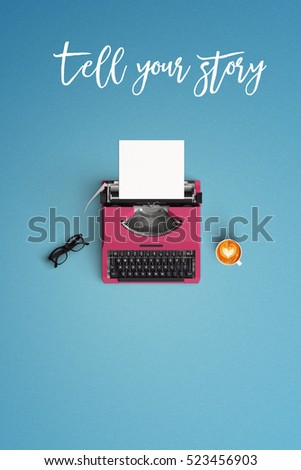 tell your story vintage typewriter with hot coffee cup on the color background #523456903
