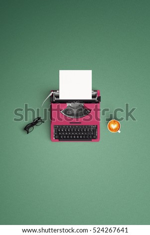 tell your story vintage typewriter with hot coffee cup on the color background #524267641