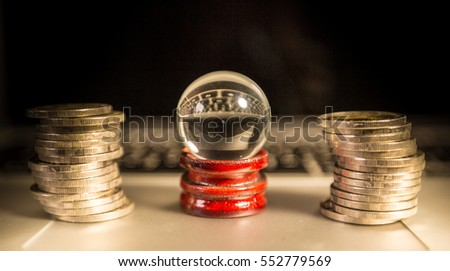 Teller crystal ball surround by coin, predict the future, forecast the future. Financial analysis, Financial advisor.  financier #552779569