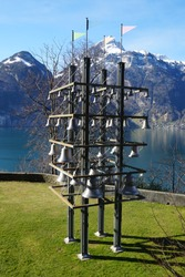 Tellsplatte Glockenspiel bells on the banks of Lake Lucern with Swiss alpine snow capped mountains in the background