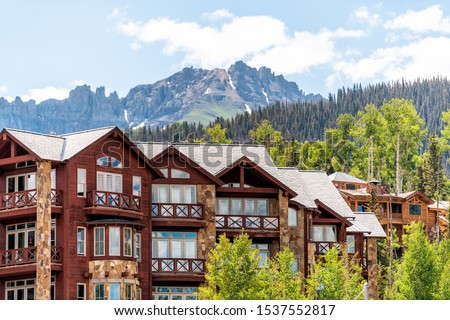 Telluride, Colorado small town Mountain Village in summer 2019 with view of San Juan Mountains and modern resort lodge apartment condo architecture