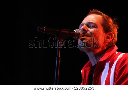 TEMPE, AZ - DEC 31: Robin Wilson, lead singer of the Gin Blossoms performs for fans celebrating New Years Eve at the Fiesta Bowl Block Party on December 31, 2011 in Tempe, AZ.