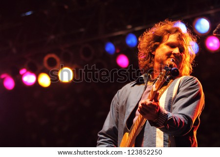 TEMPE, AZ - DEC 31: Scott Johnson, guitarist for the Gin Blossoms performs for fans celebrating New Years Eve at the Fiesta Bowl Block Party on December 31, 2011 in Tempe, AZ.