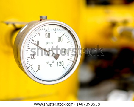 Temperature gauge for measuring instrument close up in industry zone at power plant. #1407398558