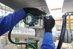 Temperature transmitter during install the power cable for measuring in steam system in gas pipeline.