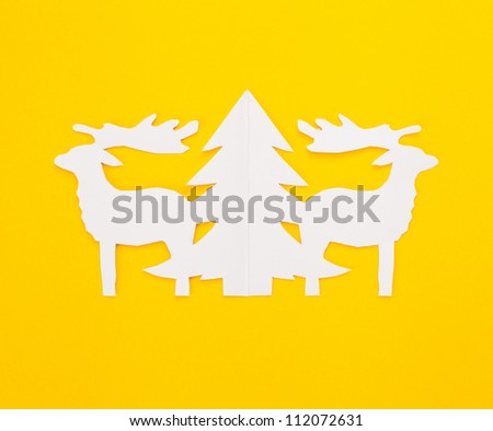 Template Christmas card.New Year's deers on a yellow background.