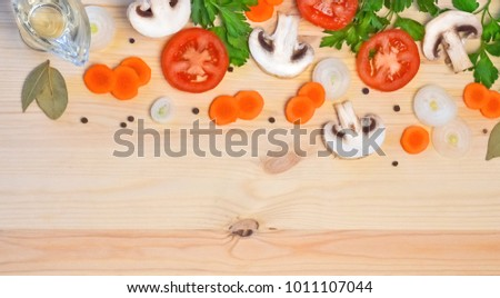 template for menu light wood background on it chopped vegetables mushrooms, carrots, parsley and dill, butter and Bay leaves and pepper #1011107044