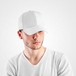 Template of a white baseball cap on a guy's head, headdress for protection from the sun, isolated on background. Sports hat mockup with visor, universal panama hat, for design presentation, front view