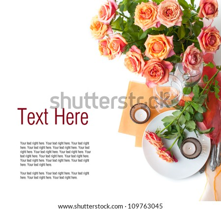 Template with festive table setting with roses and candles in shades of orange on a white background