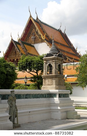 Temple and statue in wat Suthat, Bangkok, Thailand