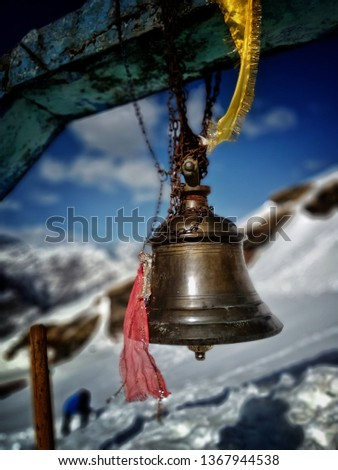 Temple bells are hanging at the entrance of Shiva Temple that is covered with snow.The most ancient Shiva temple in India. Worlds highest Tungnath Shiva temple's bells in snow. Unseen pics of bells.